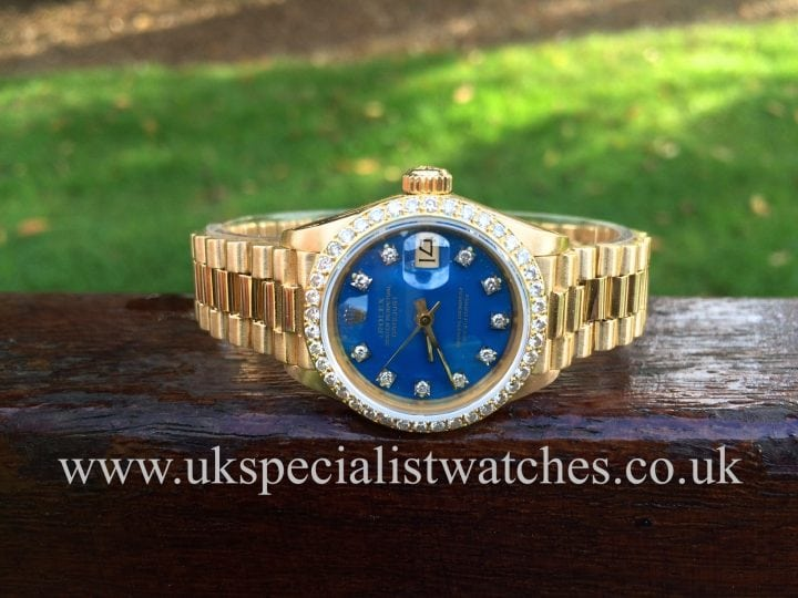 UK Specialist Watches have a wonderful Rolex Lady Datejust 18ct Gold president with a Diamond set bezel