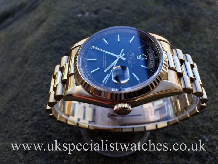 UK Specialist Watches have an 18ct Gold Black Dial Rolex Day-Date President 18238, full set 1993.