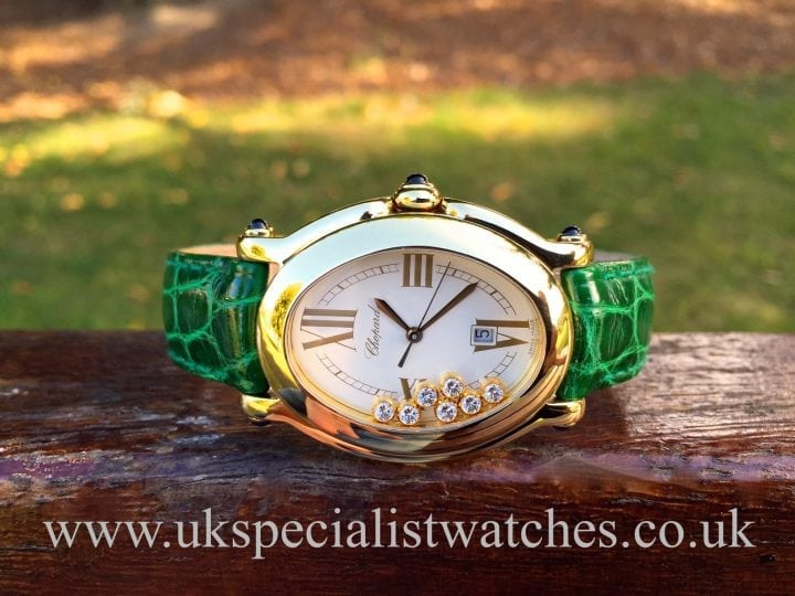 UK Specialist Watches have a beautiful ladies Chopard Happy Sport 18ct Gold with 7 floating Diamonds with pink croc strap 27/7000-23