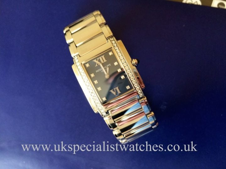 For sale at UK Specialist watches a ladys Patek Philippe Twenty-4 with a perfect Blue Dial Diamond set - 4910/10A -012