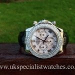 UK Specialist Watches have a white gold Rolex Daytona with silver Mother Of Pearl dial and double diamond bezel.