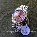 UK Specialist Watches have a 31mm MidSize Datejust in stainless steel with a salmon pink dial.