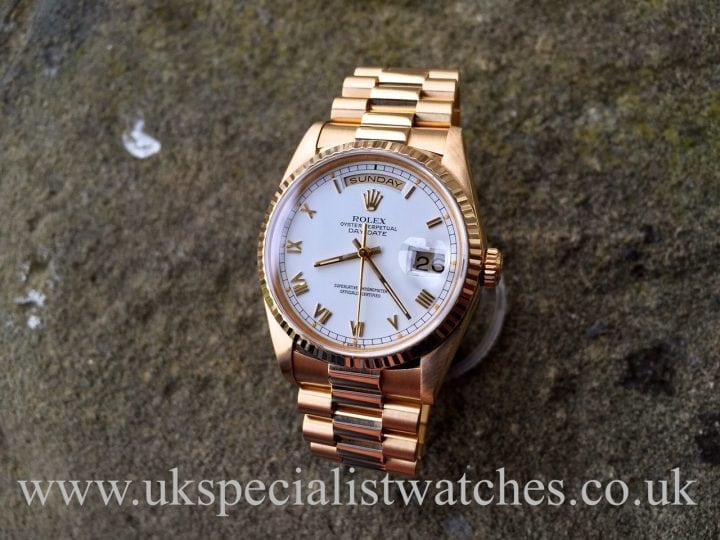 UK Specialist Watches have a Gents Rolex Day Date President with a white Roman numeral dial in 18ct yellow Gold – 18238 Box & Papers