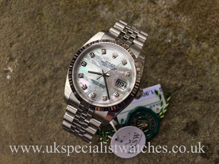 UK Specialist Watches have a brand new unworn Rolex Datejust with a factory diamond mother of pearl dial 116234