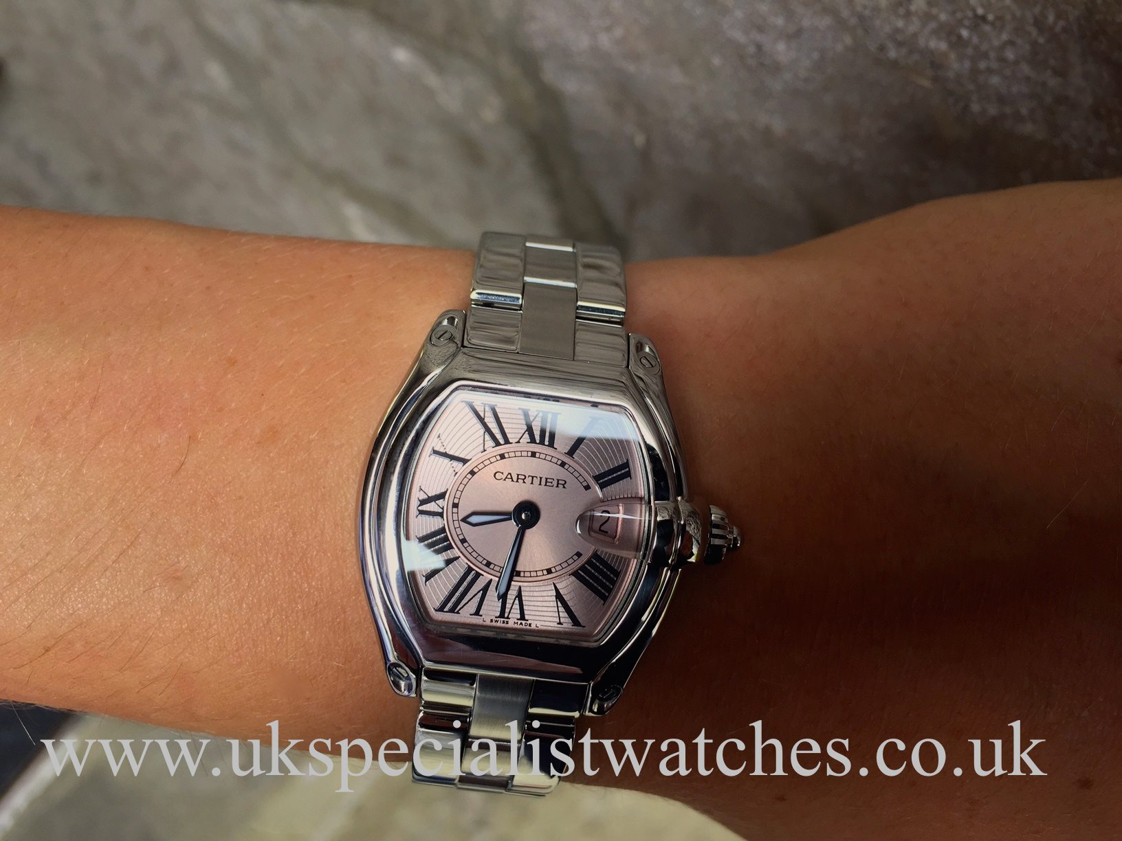 UK Specialist Watches have a mid size cartier Roadster in stainless steel  with a pink Roman 0162094919