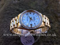 UK Specialist Watches have a Ladies Rolex Datejust mid-size 31mm in 18ct yellow gold with a factory rolex diamond bezel.