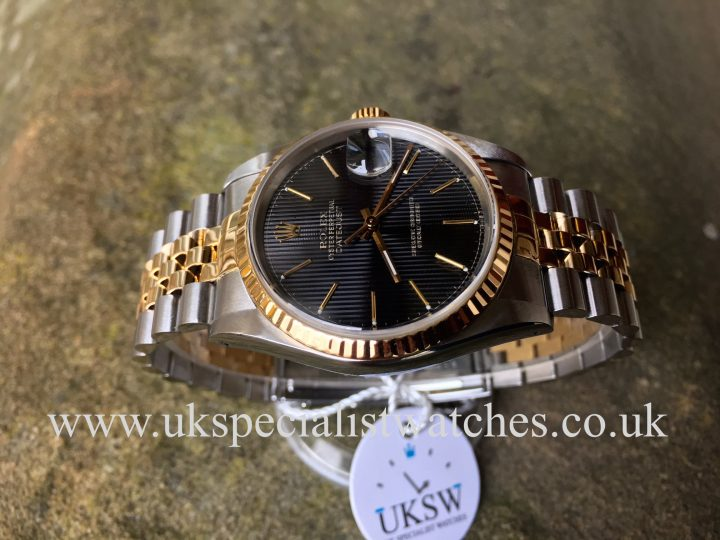 UK Specialist Watches have a Rolex Datejust 16233 with a stunning Pinstripe dial, complete with box and papers.