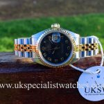 UK Specialist Watches have a stunning rare Rolex Datejust ladies 69173 with a black jubilee dial with box and papers.