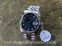 U.K Specialist Watches have a Rolex Datejust 116234 with a factory Rolex blue diamond jubilee dial with box and papers