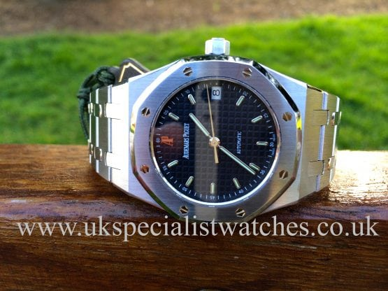 UK Specialist Watches have a Audemars Piguet Royal Oak 37mm 14790ST.OO.0789ST.08 with a navy blue dial, complete with box and papers.