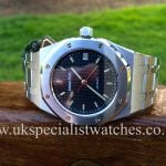 Watches have a Audemars Piguet Royal Oak 37mm 14790ST.OO.0789ST.08 with a navy blue dial, complete with box and papers.