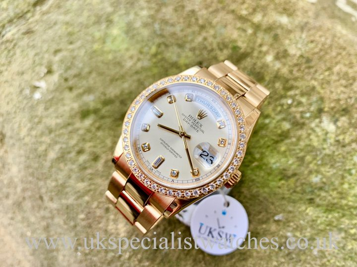ROLEX DAY-DATE – DIAMOND BAGUETTE DIAL DIAMOND BEZEL -18CT GOLD – 118208